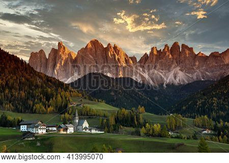 Santa Magdalena In Val Di Funes With Odle Dolomitic Group On Background At Sunset. South Tyrol In It