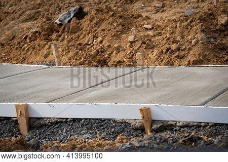 Fresh New Sidewalk Cement Ouyside Builder Contractor