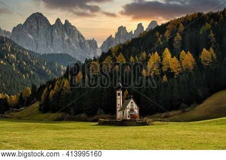 St. Johann (san Giovanni In Italian) Chapel In Val Di Funes With The Dolomites Odle Group On Backgro