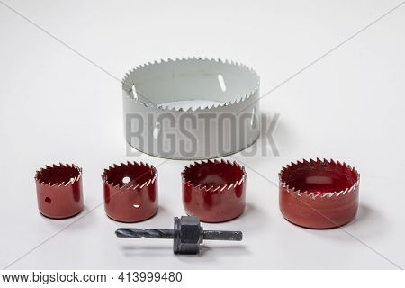 A Set Of Hole Saws In Different Sizes For Cutting Holes In Wood And Drywall.jpg