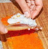 process of making sushi depicted rice and fish roe poster