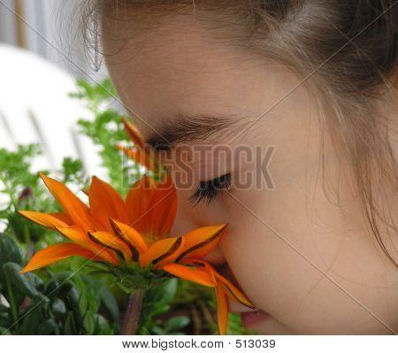 Girl Smelling Flower 2