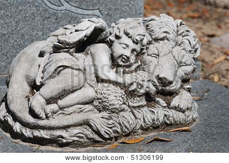 Century old lion, lamb, and angel