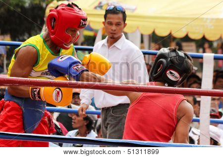 Boxers takes a left punch