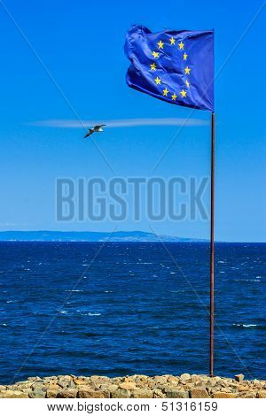 European Flag On Strengthening, Next To The Sea Border.