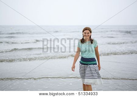 Young Happy Woman Walking On The Beach Of St.peter Ording, North Sea,