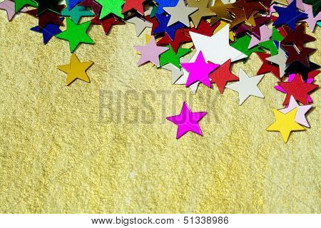 Colorful Stars On Gold Background, Close Up