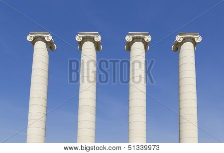 Four white columns near Royal palace. The columns symbolizing the four stripes of the Catalan flag poster