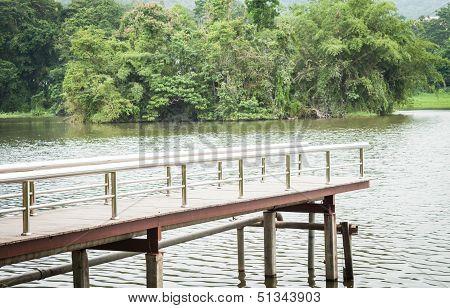 Metal Bridge Into The Water