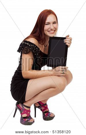 Young Woman Smiles While Holding A Blank Tablet Computer.
