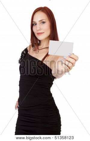 Confident Woman With Red Hair Holds Up A Blank Business Card.