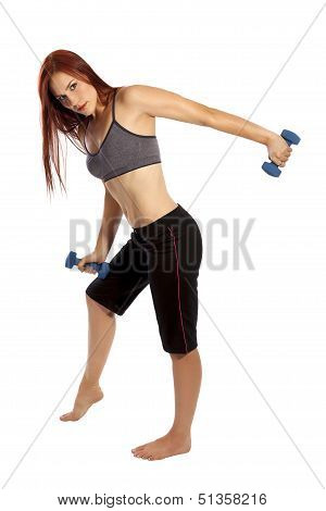 Pretty Woman With Red Hair Works Her Triceps With Hand Weights.