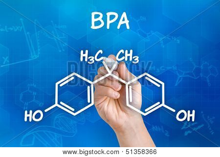 Hand with pen drawing the chemical formula of BPA