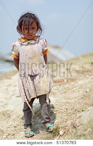 NAGARKOT, NEPAL - APRIL 5: Portrait of little unidentified Nepalese girl on April 5, 2009 in Nagarkot Village, Kathmandu, Central Region, Nepal.