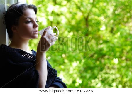 Lovely Girl With A Mug Of Coffee