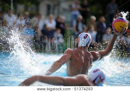 KAPOSVAR, HUNGARY - SEPTEMBER 15: Oliver Kovacs (3) in action at a Hungarian national championship water-polo game between Kaposvar (white) and Honved (blue) on September 15, 2013 in Kaposvar, Hungary