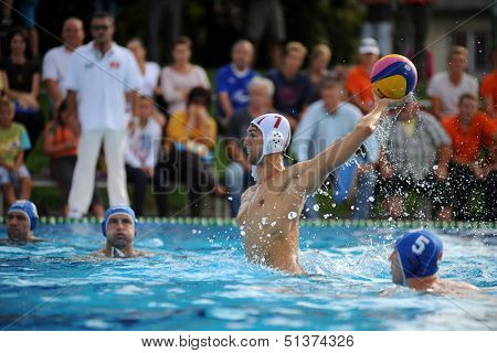 KAPOSVAR, HUNGARY - SEPTEMBER 15: Farkas Dory (7) in action at a Hungarian championship water-polo game between Kaposvar (white) and Honved (blue) on September 15, 2013 in Kaposvar, Hungary