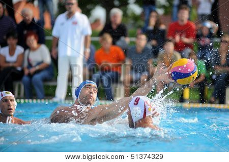 KAPOSVAR, HUNGARY - SEPTEMBER 15: Barnabas Steinmetz (in blue) in action at a Hungarian championship waterpolo game between Kaposvar (white) vs Honved (blue) on September 15, 2013 in Kaposvar, Hungary