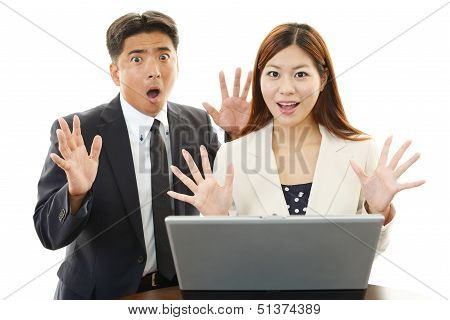 Surprised businessman and businesswoman