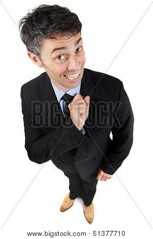 Obsequious businessman with a toothy beaming sycophantic smile standing looking perky and wide eyed looking up at the camera, high angle fun portrait isolated on white