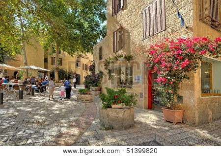 JERUSALEM - AUGUST 21: Narrow cobbled streets of Jewish Quarter with bars, restaurants and shops - popular travel destination for tourists visiting Old City in Jerusalem, Israel on August 21, 2013.
