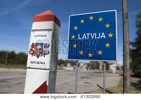 General Schengen country border sign of Latvia located on the border between Latvia and Lithuania.