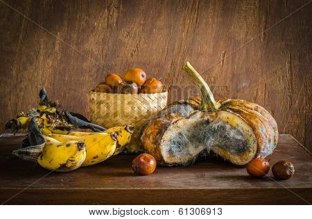 Old Pumpkin,bananas And  Monky Apple On Table