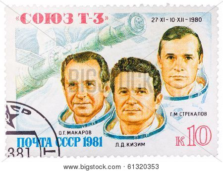 Stamp Printed In Ussr Shows The Soviet Cosmonauts Makarov, Kizim, Strekalov And A Transport Spaceshi