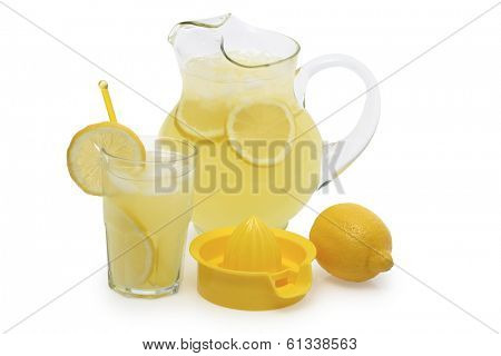 Still life of lemonade in pitcher and glass with full lemon on side