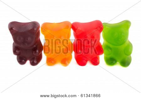 Row of colorful gummy bears on isolated white background