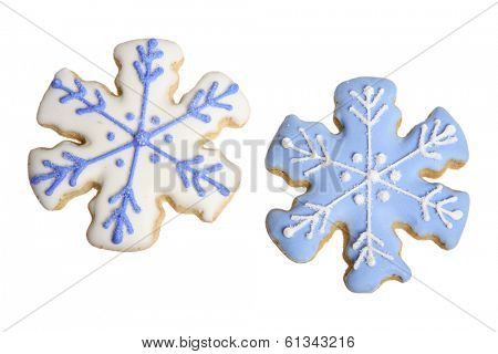 two sugar cookies with blue and white icing