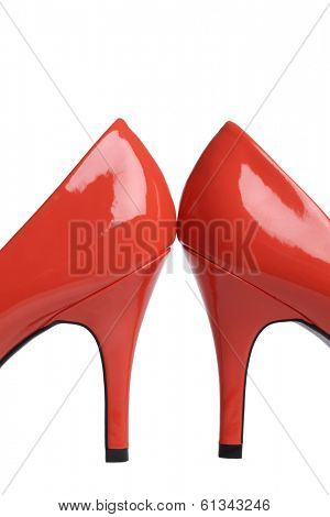 Red high heel shoes on white background