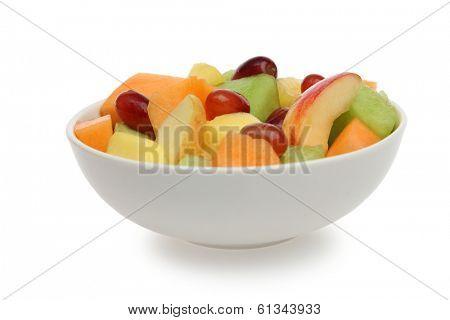 Bowl of fresh fruit on white background