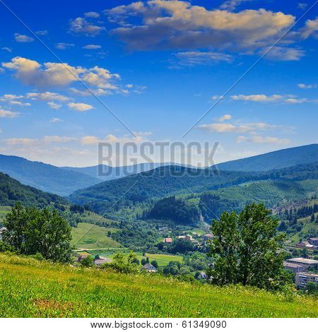 Village In Mountain Foot Valley With Forest