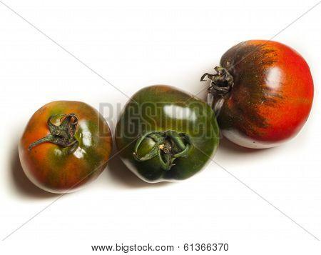 three organic tomatos
