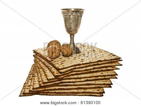 Matzo silver Kiddush cup and three walnuts