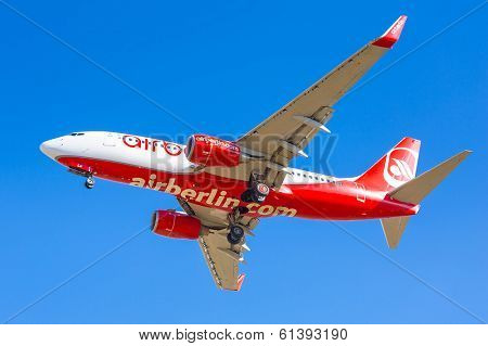 GDANSK AIRPORT, POLAND - 13 MAR: Air Berlin plane landing on Lech Walesa Airport in Gdansk on March 13, 2014. Air Berlin is second largest airline in Germany carried over 33 million passengers a year.