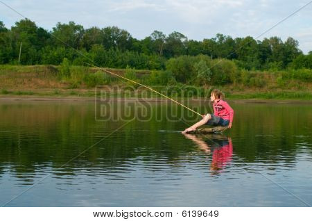 Fisher Sits On A Log