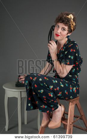 Pinup Girl Looks Exasperated While On Old-fashioned Telephone