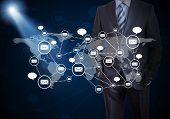 Businessman and network of contacts illuminated beam. The concept of global contacts poster