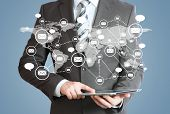 Man in suit, tablet pc and contacts. The concept of global contacts poster