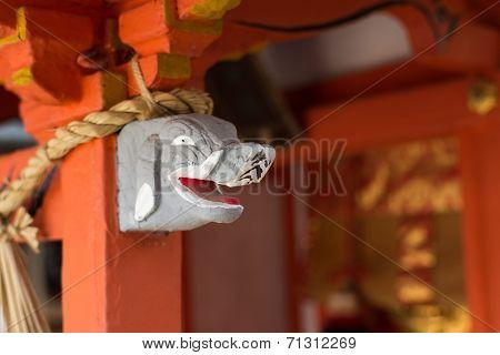 Gray elephant head statue on the  stigmatic of colum in Fushimi Inari Taisha Shrin.