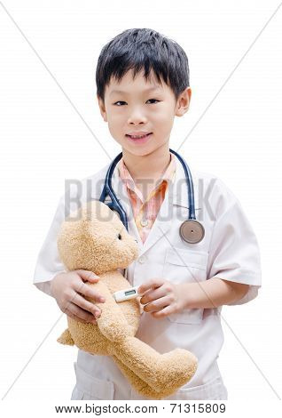 Asian Doctor Boy Playing And Measuring Temperature Bear Toy