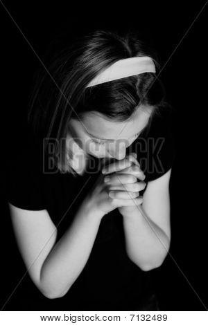 Praying child in black and white