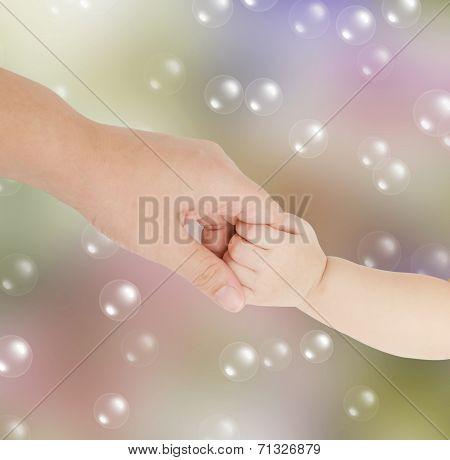 Baby Hand Holding Her Mother Finger