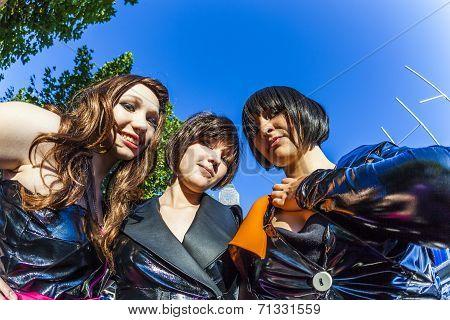 Three Girls In Black In Costume Pose At Frankfurt International Bookfair As Mangas