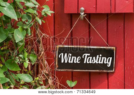 Old metal sign with the inscription Wine Tasting