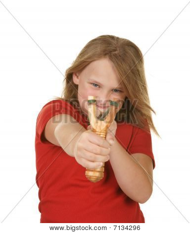 naughty little girl with a slingshot