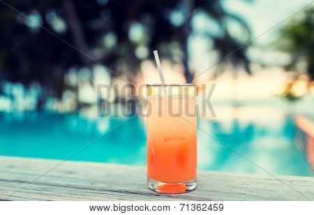 summer, beach, drink, cocktail and leisure concept - cocktail drink on tropical beach
