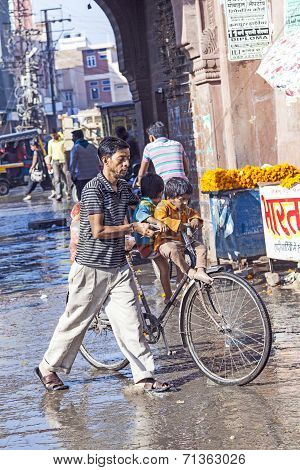 Man With Child At The Old City Gate In Bikaner With His Bicycle